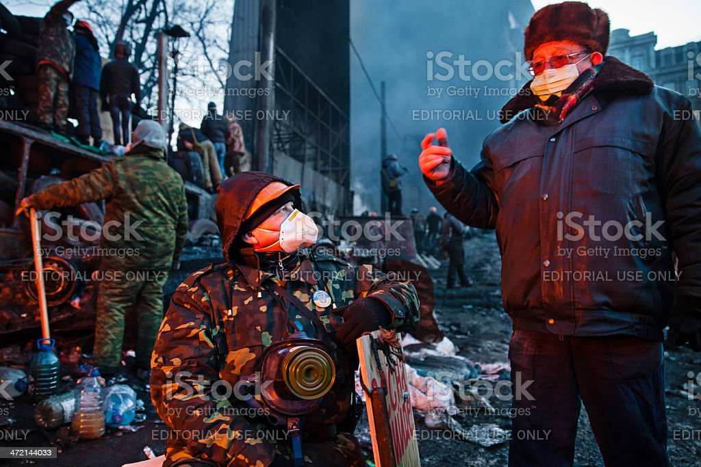KIEV, UKRAINE - January 26, 2014: Euromaidan protesters rest and royalty-free stock photo