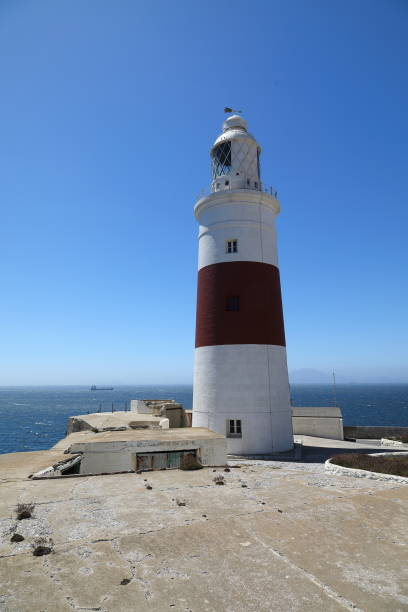 europa point lighthouse - gibraltar, uk - pejft stock photos and pictures