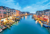 Europe. Aerial view of city buildings along Rialto Bridge at night, Venice - Italy.