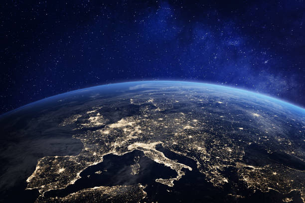 europe at night from space, city lights, elements from nasa - globale foto e immagini stock