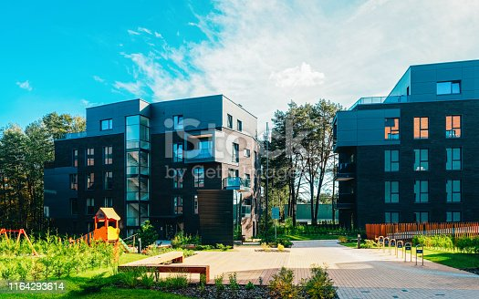 949087660 istock photo Europe Children playground at complex of residential buildings 1164293614