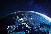 Europe from space at night with city lights showing European cities in Germany, France, Spain, Italy and United Kingdom (UK), global overview, 3d rendering of planet Earth, elements from NASA. Some elements from NASA (https://eoimages.gsfc.nasa.gov/images/imagerecords/57000/57752/land_shallow_topo_2048.jpg)