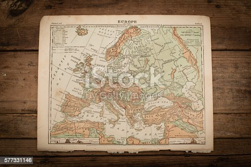Color stock photo of an antique Europe map illustration page on an old, wooden trunk. Salvaged from an 1871 geography book.