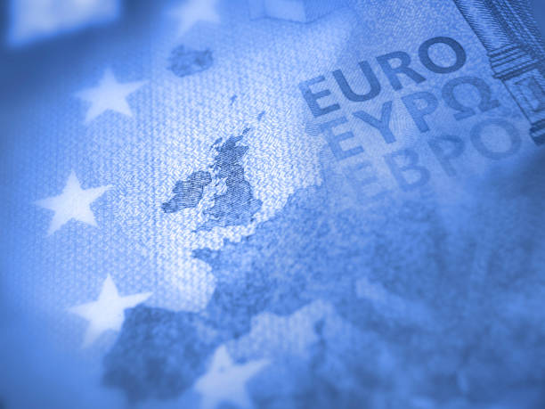 Europe map of Euro bill with focus on Great Britain. Brexit concept Unfocused Euro bill close up detail of Europe map with focus on Great Britain. Brexit concept in blue color euro symbol stock pictures, royalty-free photos & images