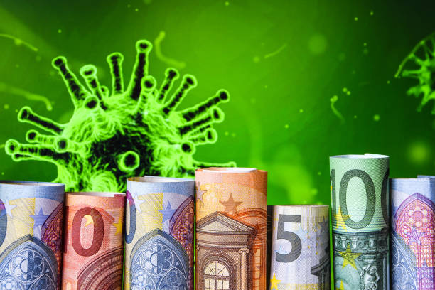 Europe stockmarket chart downtrend with banknote background, Covid19 virus pandemic crisis, euros rolled up stock photo