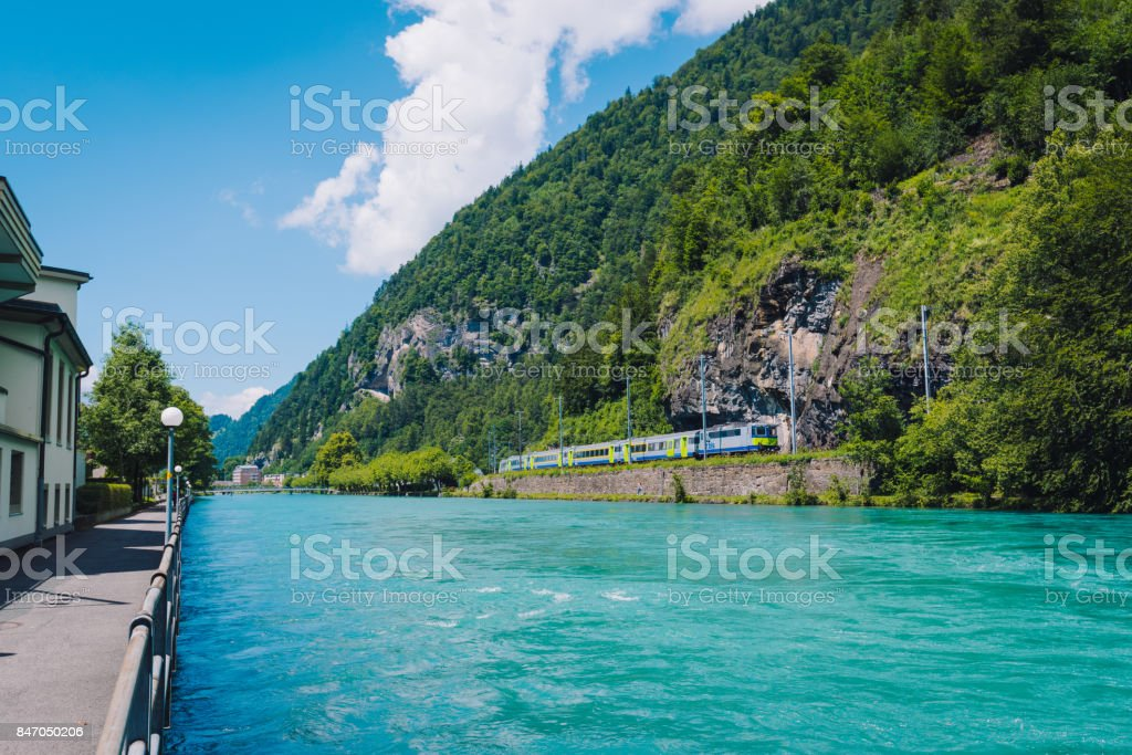 Europe train in Interlaken town with Thunersee river stock photo