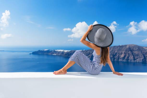 Europe vacation destination luxury Oia hotel woman stock photo