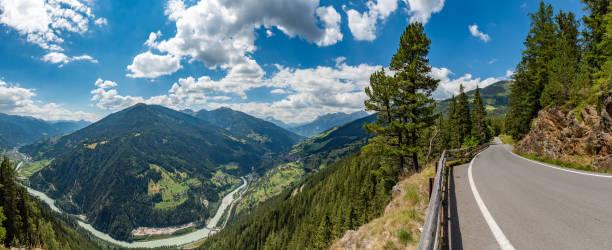 European alpine landscape with mountain road stock photo