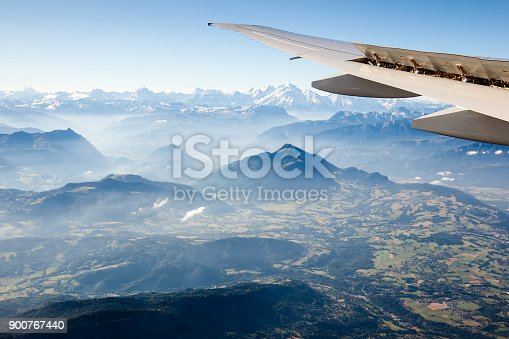 900763322 istock photo European Alps from the air through the airplane window 900767440