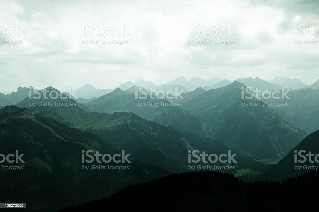european alps silhouette with dark foreground royalty-free stock photo