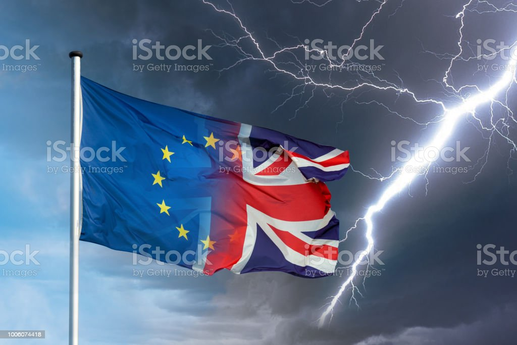 European and british flag merging with dark clouds and lightning bolt as sign for Brexit stock photo
