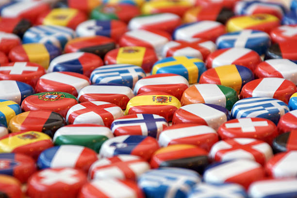 European Background Flags of European nations on beer bottle caps. Strong DOF, with main focus on caps at center.   davelongmedia stock pictures, royalty-free photos & images