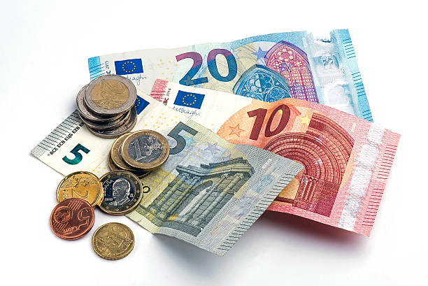European banknotes and coins European banknotes and coins on white background. european union coin stock pictures, royalty-free photos & images