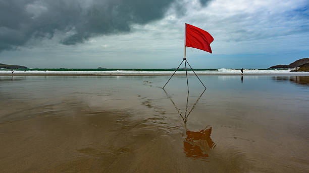 European beach with a red flag warning stock photo