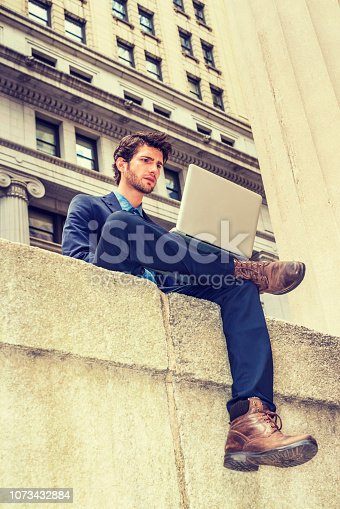istock European businessman traveling, working in New York 1073432884