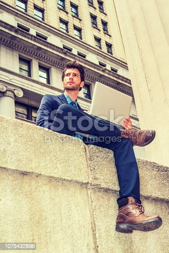 istock European businessman traveling, working in New York 1073432896