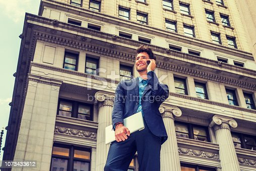istock European businessman traveling, working in New York 1073433612