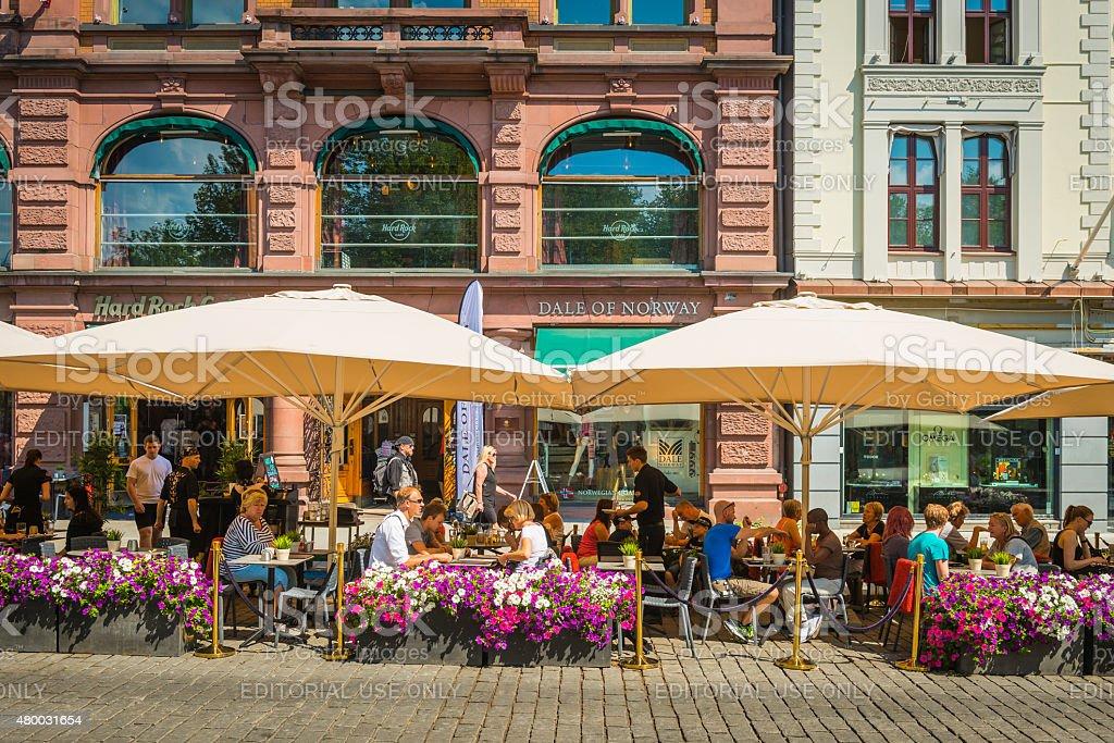 European cafe culture people enjoying al fresco dining Oslo Norway stock photo