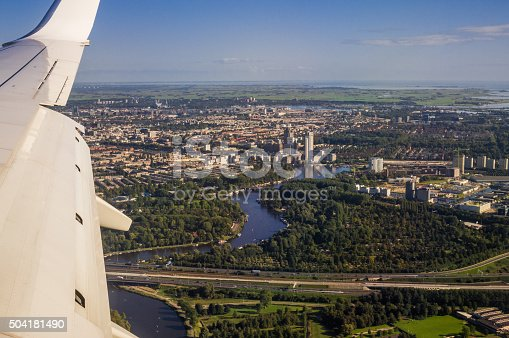 istock European Capital City Amsterdam Aerial View from Jet Aircraft Porthole 504181490