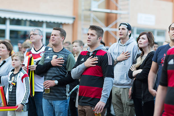 european championship german soccer singin national anthem - national anthem stock photos and pictures