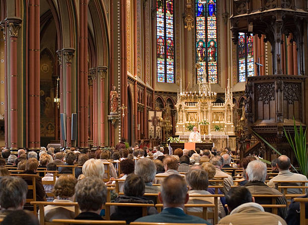"""European church service """"Full church, with Roman Catholic service.Location: Belgium."""" place of worship stock pictures, royalty-free photos & images"""