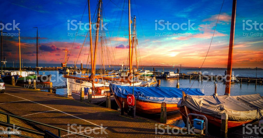 European Cities - Holland Amsterdam Volendam city harbour and fishing boats on a cloudy beautiful sunset stock photo
