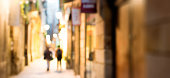 Two women walking on a street in the Spanish city of Barcelona.  Defocused in camera.