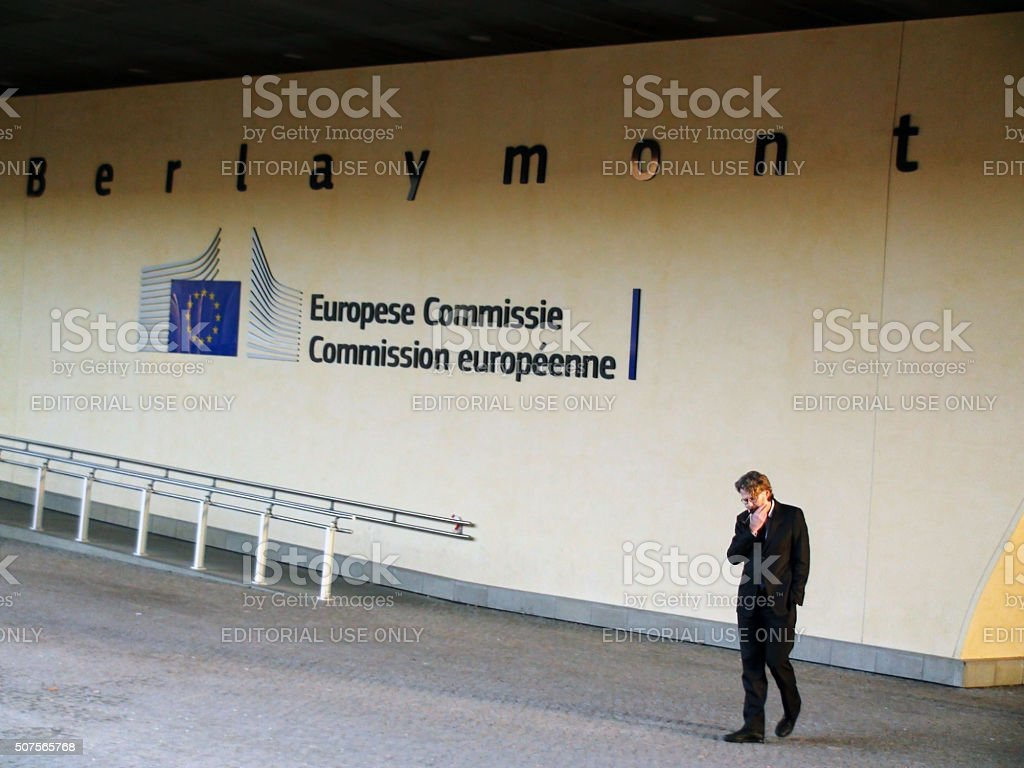 European Commission Building And A Gentleman Standing Smoking In Brussels.Belgium.Europe stock photo