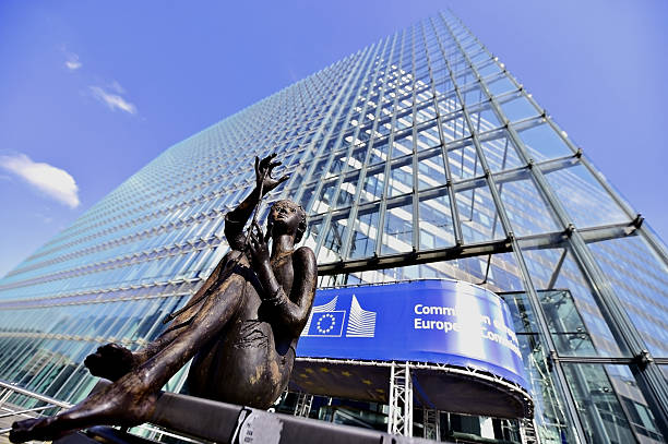 European Commission Headquarters statues Brussels, Belgium - March 16, 2016: Statue in front of the European Commission Headquarters, also know as the Berlaymont building. berlaymont stock pictures, royalty-free photos & images