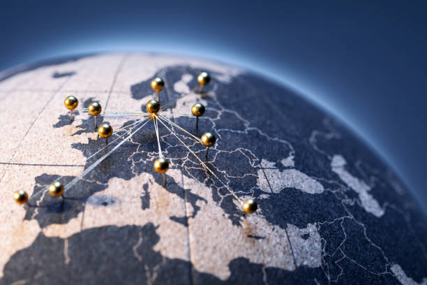 European Connection - Golden pins on cork board globe stock photo