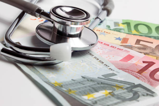 european currency with doctor stethoscope. - social security check stock photos and pictures