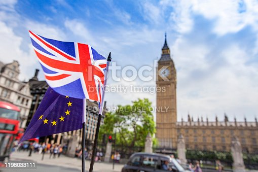 2nd June, 2017 - European flag flying alongside the British Union Jack in front of the Houses of parliament, Westminster, London.