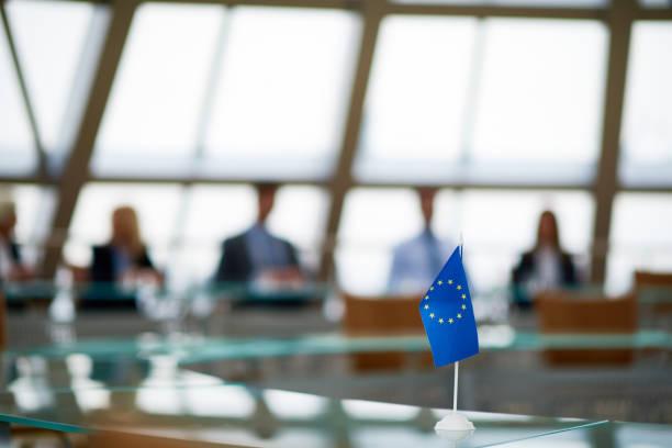 european flag on board table - политика и правительство стоковые фото и изображения