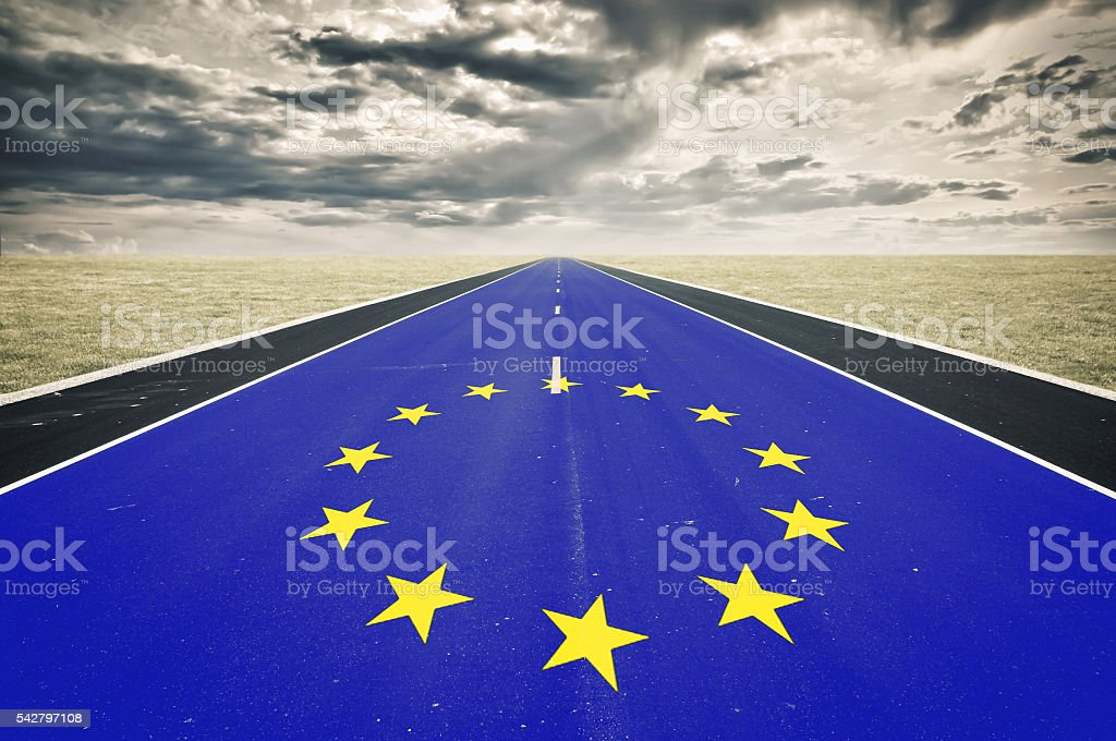 European flag, road perspective, dark clouds, crisis concept stock photo