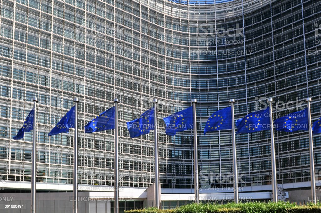 European flags in front of the Berlaymont building headquarters of the European commission in Brussels. stock photo