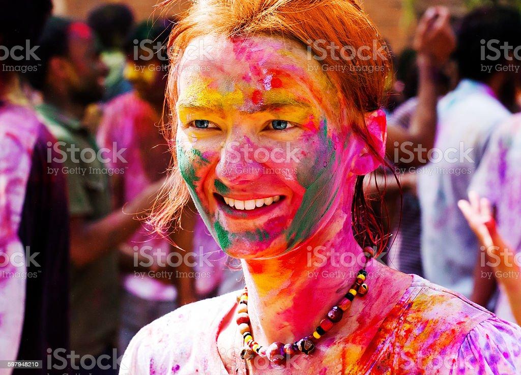 European girl celebrate festival Holi in Delhi, India. stock photo
