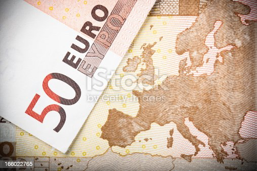 Euro notes close-up:  Macro image of two €50 banknotes, with focus on the map of Europe.