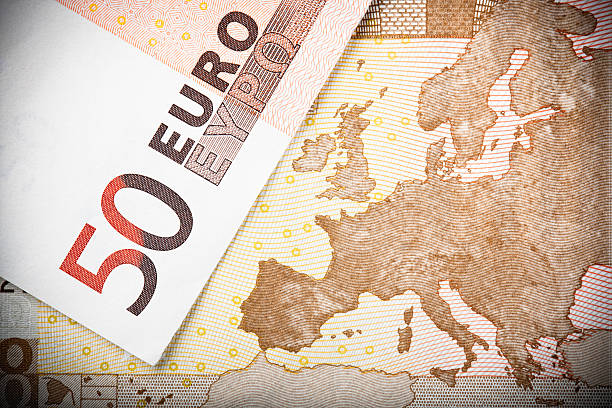 European Map on €50 Note Euro notes close-up:  Macro image of two €50 banknotes, with focus on the map of Europe. fifty euro banknote stock pictures, royalty-free photos & images