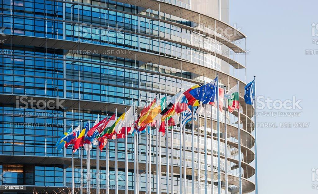 European Parliament facade with all EU European Union Country flags stock photo