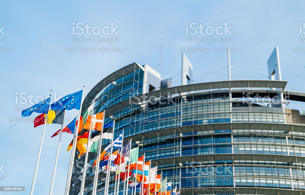 European Parliament flags in front of the main building stock photo