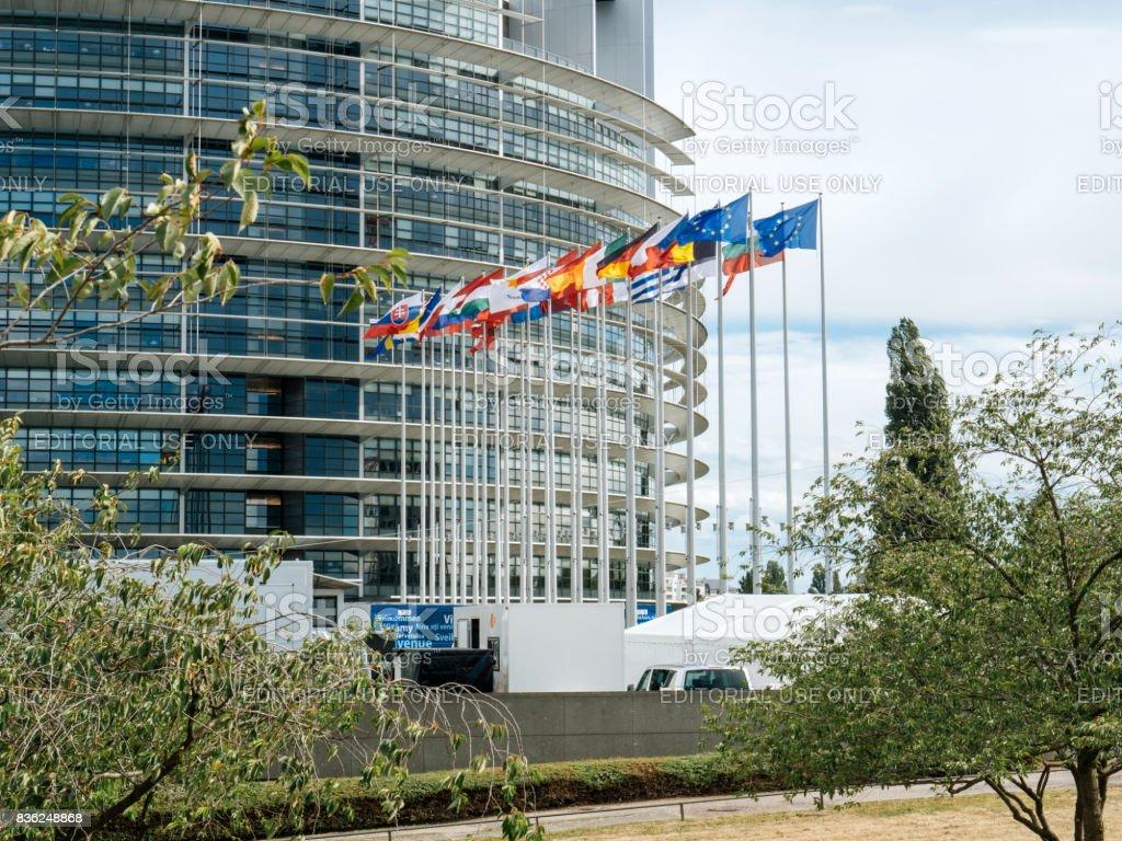 European Parliament flags waving at sunset stock photo