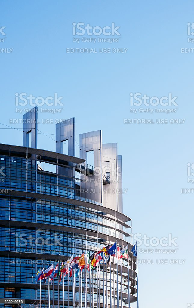 European parliament on a clear day with all EU Flags stock photo