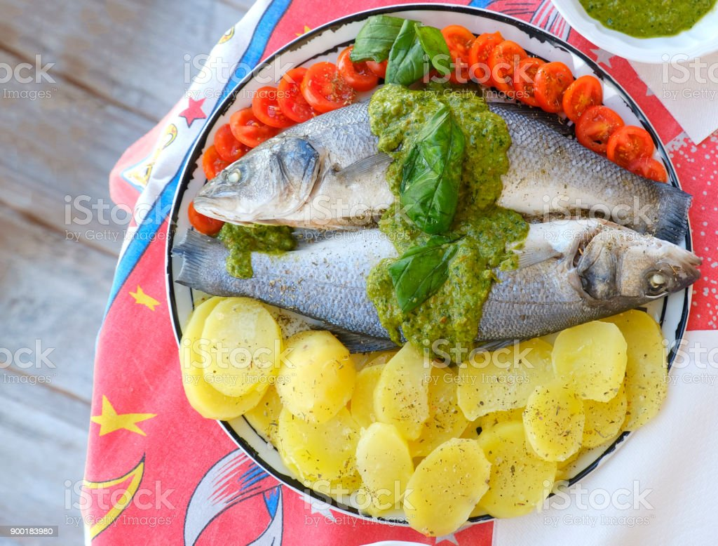 european sea bass branzino steaming basil sauce recipe high angle up view stock photo