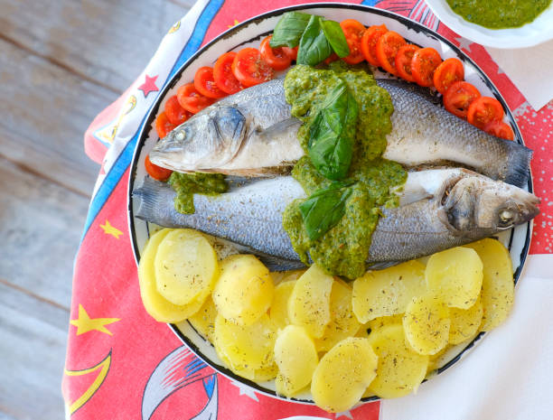 european sea bass branzino steaming basil sauce recipe high angle up view stock photo