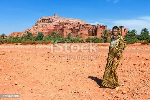 872393896istockphoto European tourist in picturesque mountain village kasbah Ait Ben Haddou not far from Ouarzazate in Morocco, Africa 872394886