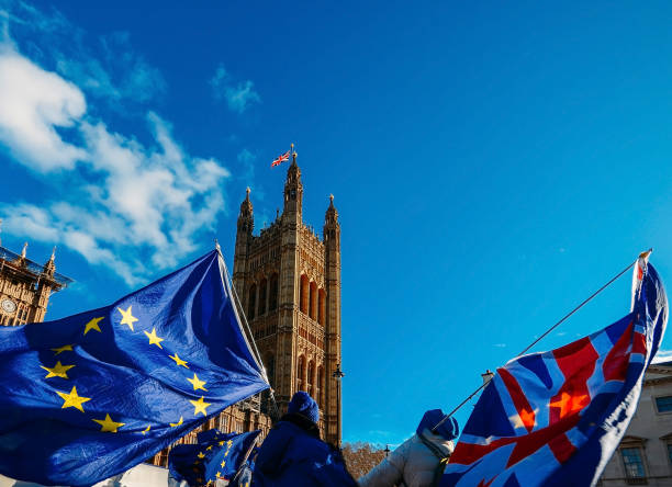 European Union and British Union Jack flag flying in front of Houses of Parliament at Westminster Palace, London stock photo