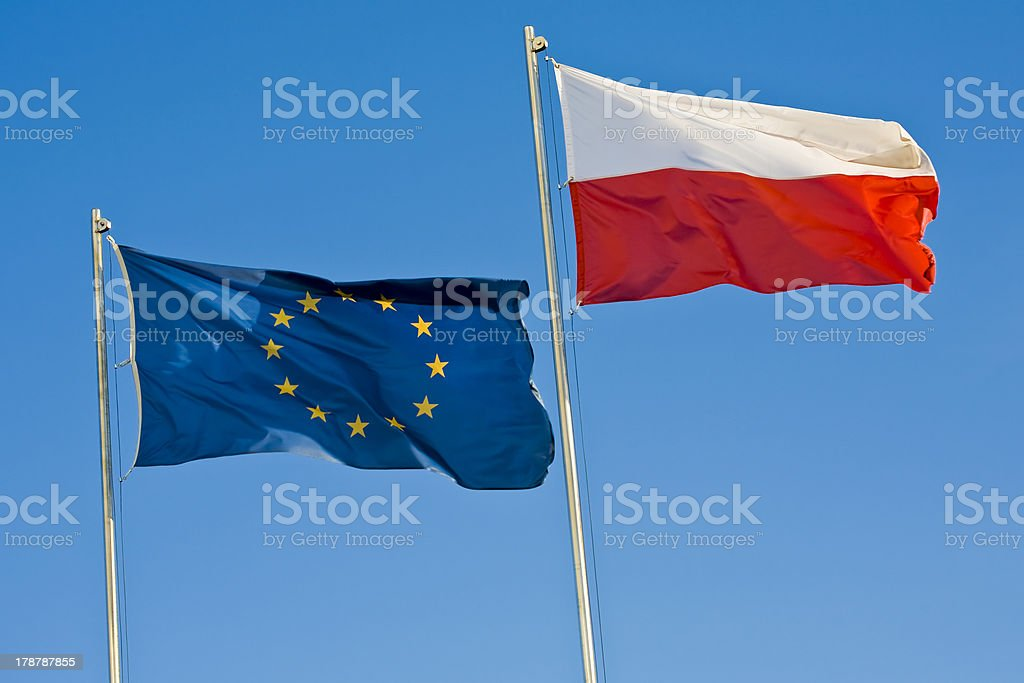 European Union and Polish flag on clear blue sky. royalty-free stock photo