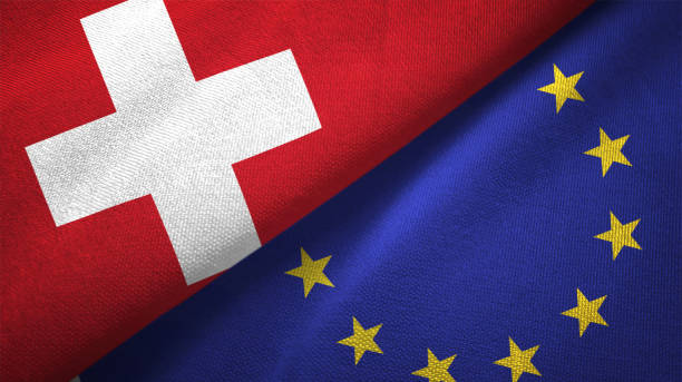 european union and switzerland two flags together realations textile cloth fabric texture - швейцария стоковые фото и изображения