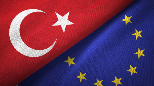 European Union and Turkey two flags together textile cloth fabric texture stock photo