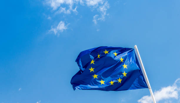European Union EU flag against a blue sky. Soon there will be one less star since the UK voted to leave the EU in 2016, stock photo